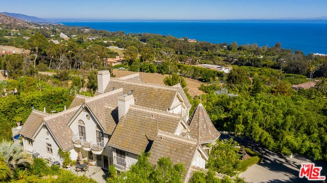 Victorian style luxury house that sits in the middle of lush greeneries overlooking a panoramic Malibu ocean view.