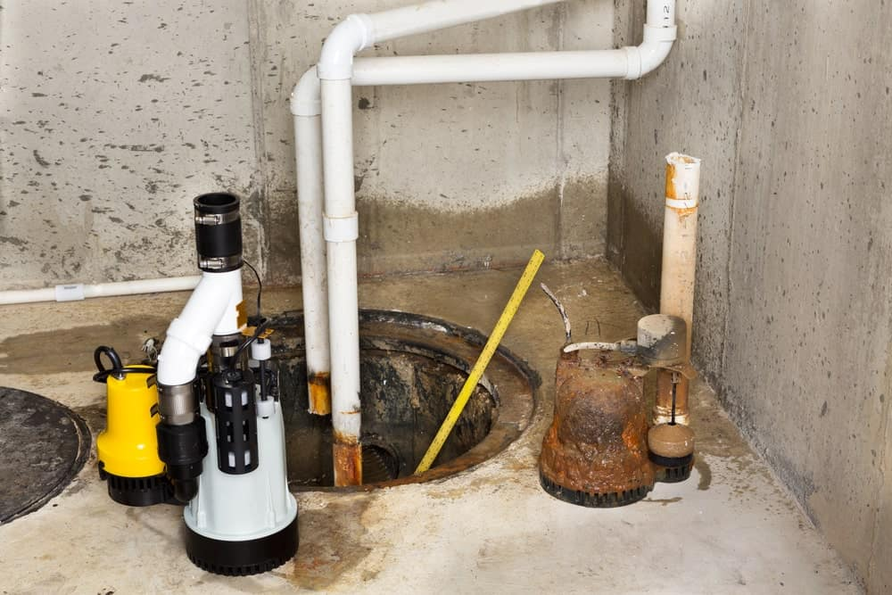 Replacing the old sump pump in a basement with a new one to drain the collected ground water from the sump or pit.