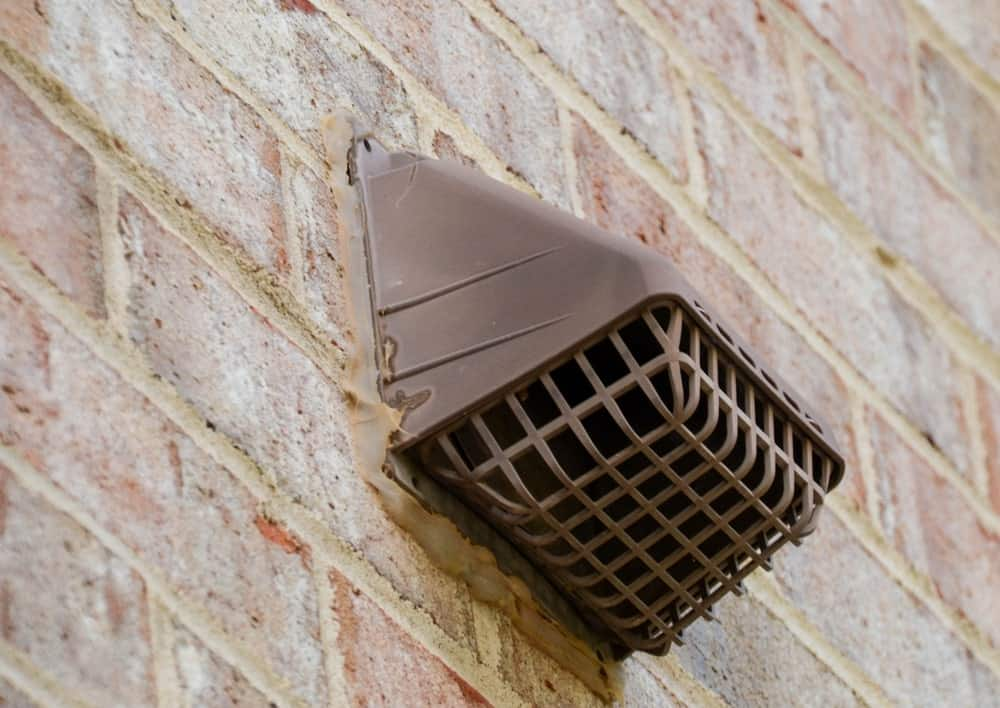 House dryer vent on a brick house.