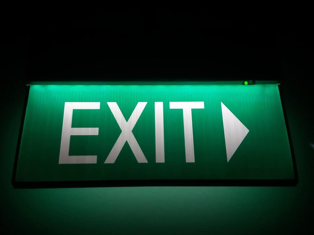 Exit sign in a basement.