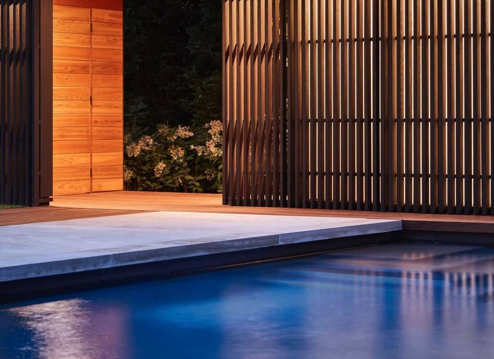 Entryway in the backyard pool of the Forest Hill Garden & Pavilion designed by Amantea Architects.