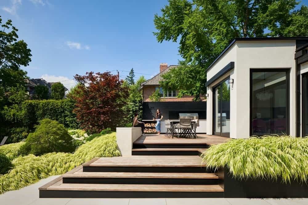 Dining terrace in the Forest Hill Garden & Pavilion designed by Amantea Architects.