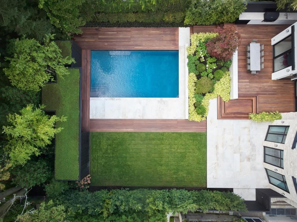 Bird's-eye view of the pool and patio in the Forest Hill Garden & Pavilion designed by Amantea Architects.