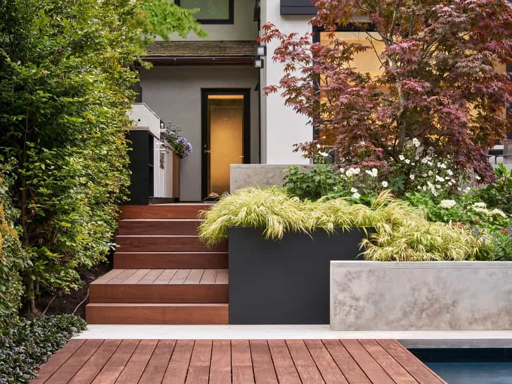 Backyard pool and deck in the Forest Hill Garden & Pavilion designed by Amantea Architects.