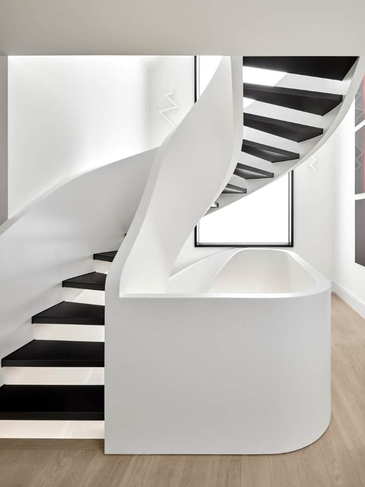 Spiral staircase in the Forest Hill House designed by Reigo & Bauer.