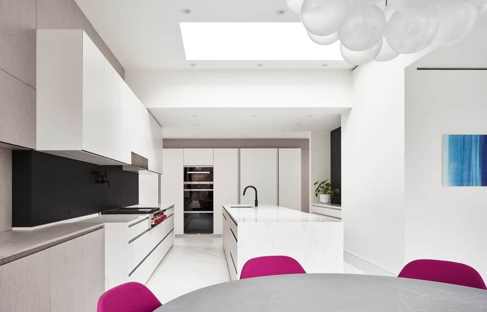 Eat-in kitchen in the Forest Hill House designed by Reigo & Bauer.