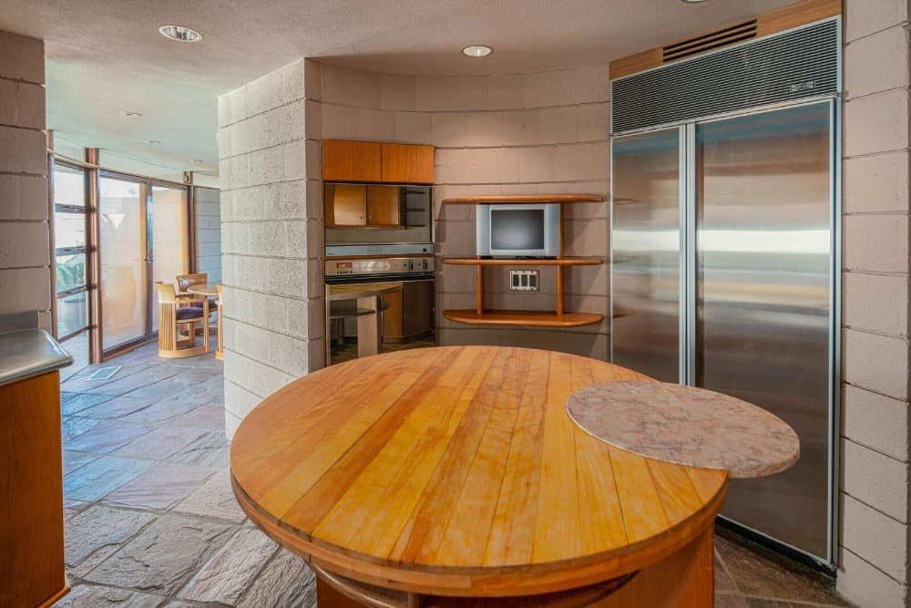 A focused look at the kitchen's center island for meal preparation. Images courtesy of Toptenrealestatedeals.com.