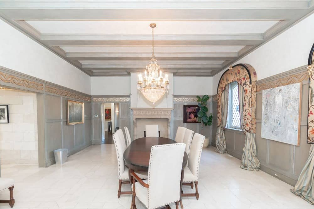 Here is one of the dining rooms, featuring an oval-shaped table paired with charming chairs, lighted by a fancy chandelier. Images courtesy of Toptenrealestatedeals.com.