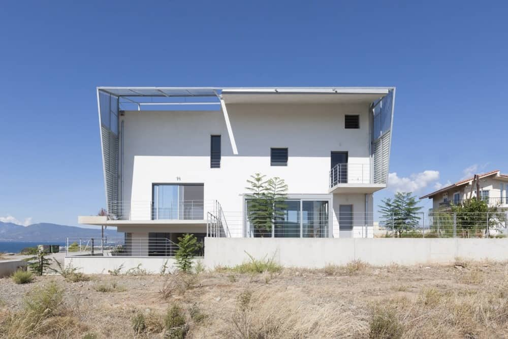 House back exterior of the Hidden Cross Residence designed by Ntovros Vasileios Architects.