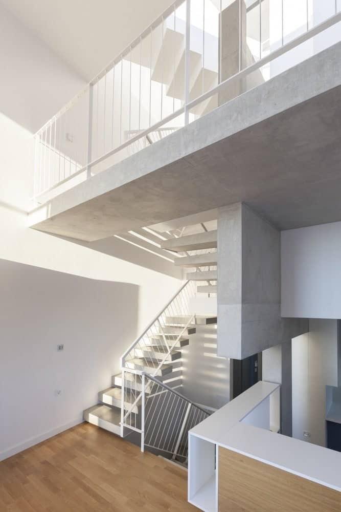 Staircase landing in the Hidden Cross Residence designed by Ntovros Vasileios Architects.