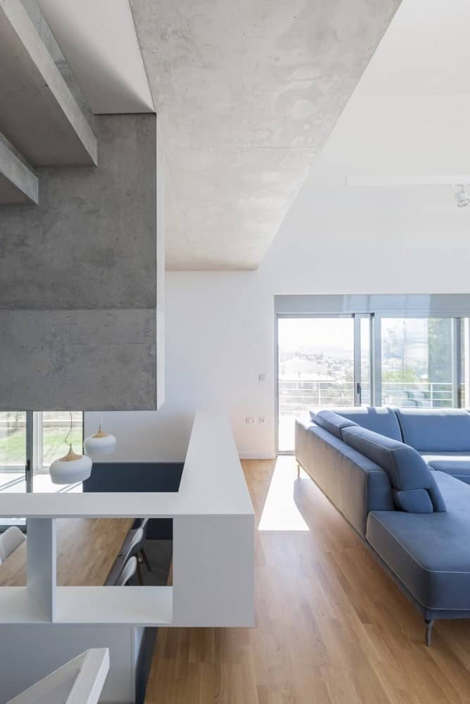Living and dining areas in the Hidden Cross Residence designed by Ntovros Vasileios Architects.