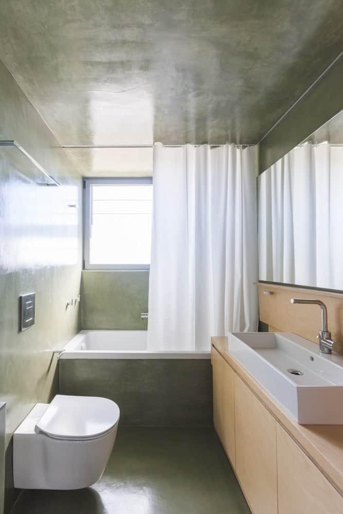 Bathroom in the Hidden Cross Residence designed by Ntovros Vasileios Architects.