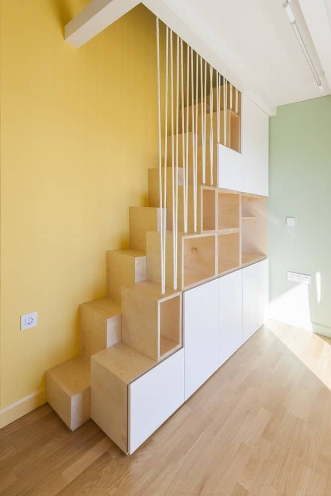 Wooden staircase in the Hidden Cross Residence designed by Ntovros Vasileios Architects.