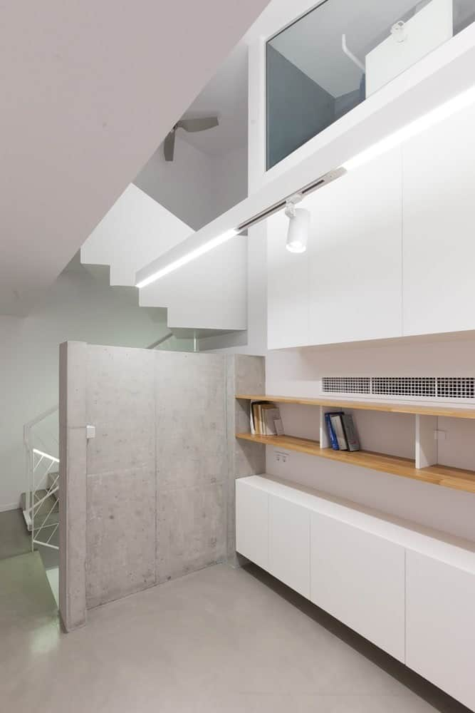 Built-in cabinets and shelvings in the Hidden Cross Residence designed by Ntovros Vasileios Architects.