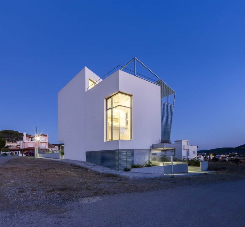 House exterior of the Hidden Cross Residence designed by Ntovros Vasileios Architects.