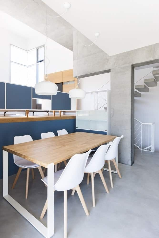 Dining space in the Hidden Cross Residence designed by Ntovros Vasileios Architects.