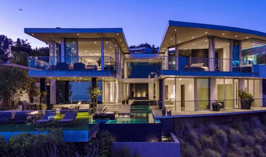 A luxurious contemporary mansion with excellent glass panel work, stunning water feature and a tranquil pool that serves as the central highlight of the house.
