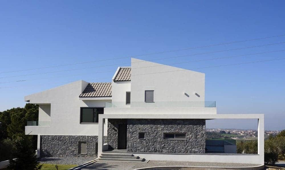 This house boasts a pretty exterior that is being showcased in this view.