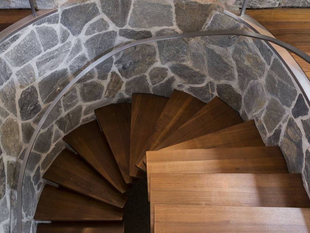 Here's the stylish floating-style spiral staircase with wooden steps and a steel handrail. Images courtesy of Toptenrealestatedeals.com.
