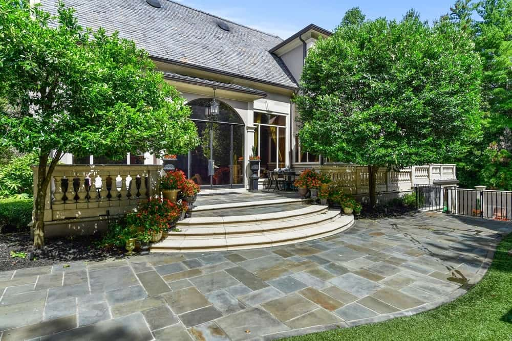 This is the side entry of the house near the garden area. It has a nice walkway and is surrounded by beautiful greenery. Images courtesy of Toptenrealestatedeals.com.