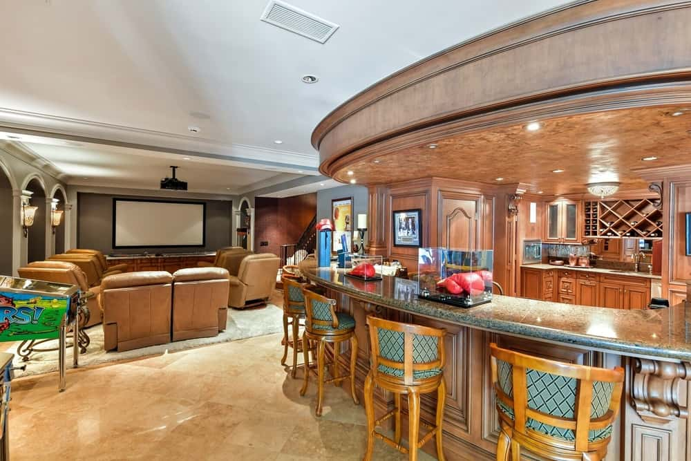 There's a man cave too, offering a small home theater area with sectional seats and a theater TV along with a large bar area with a nice counter. Images courtesy of Toptenrealestatedeals.com.