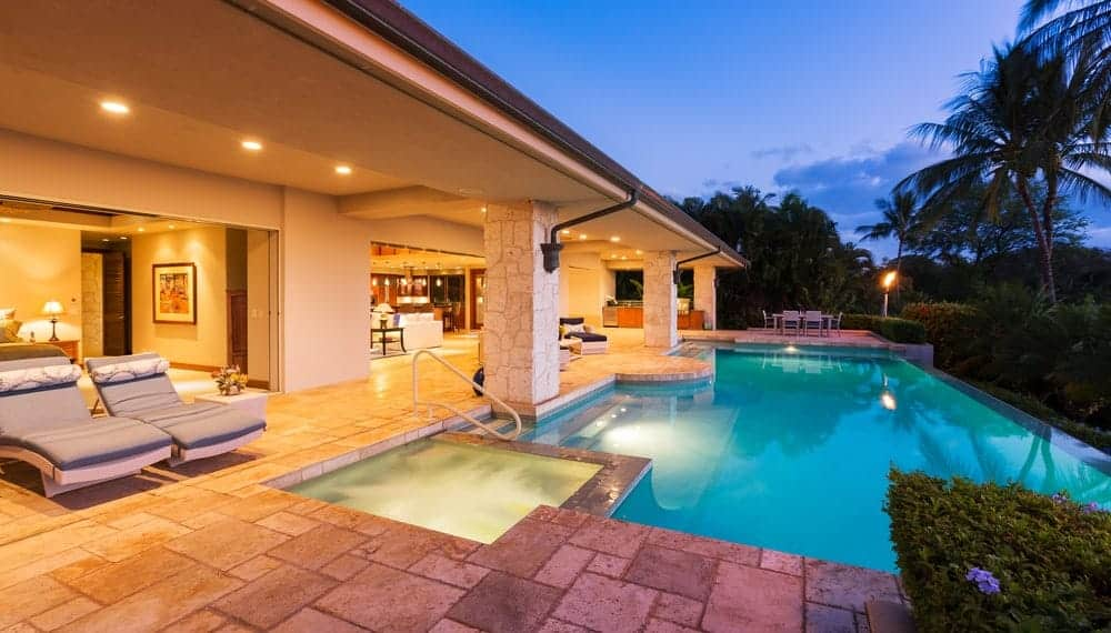 Luxury home with an infinity pool that's integrated with a custom spa.