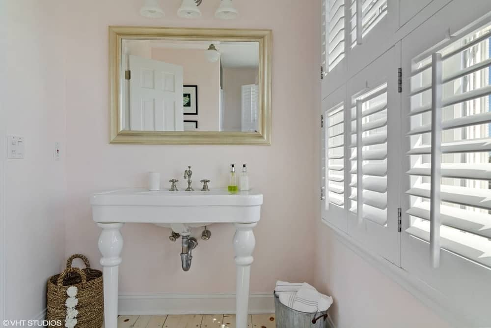 Here's a closer look at the bathroom's classic white sink with a mirror on the wall. Images courtesy of Toptenrealestatedeals.com.