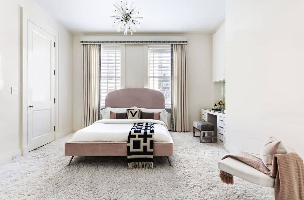 This bedroom suite features a comfy bed set with a desk and chair on the side. The room also features lovely carpet flooring. Images courtesy of Toptenrealestatedeals.com.