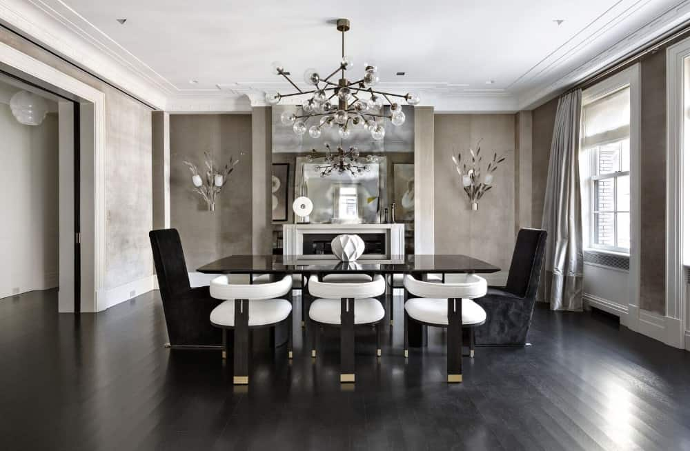 A large dining room offering a modern elegant dining table and chairs set lighted by a breathtaking ceiling light. Images courtesy of Toptenrealestatedeals.com.