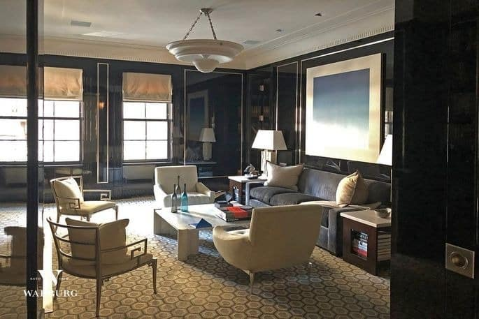 This living room boasts an elegant black walls and stylish carpet flooring, along with a classy sofa set. Images courtesy of Toptenrealestatedeals.com.