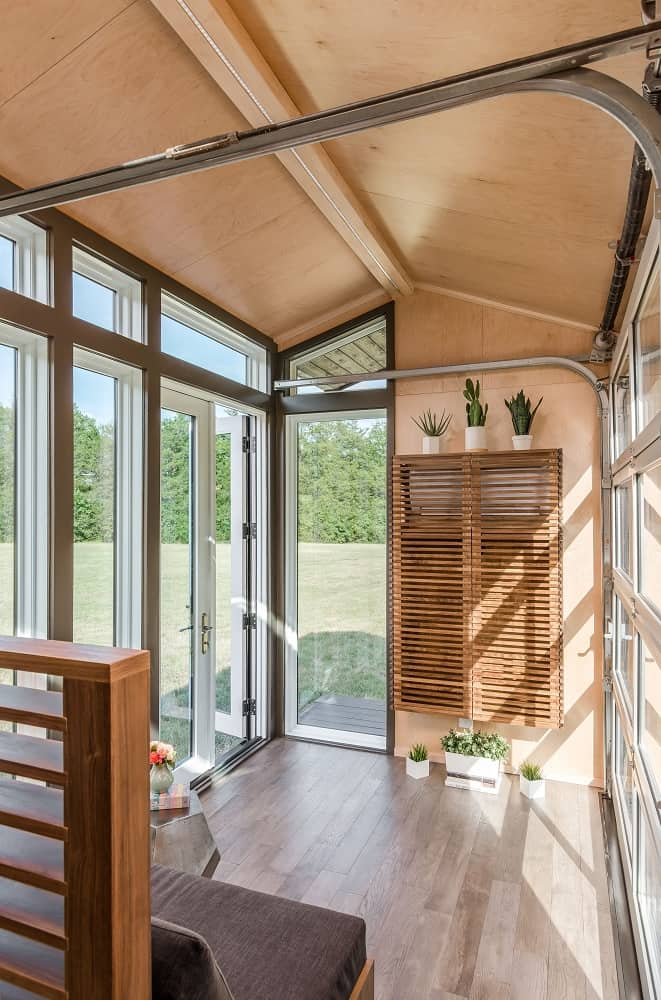 Living area in the Orchid Tiny House designed by New Frontier Tiny Homes.