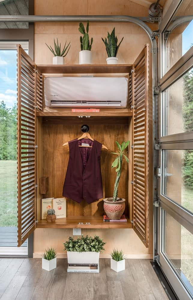 Louvered cabinet in the Orchid Tiny House designed by New Frontier Tiny Homes.
