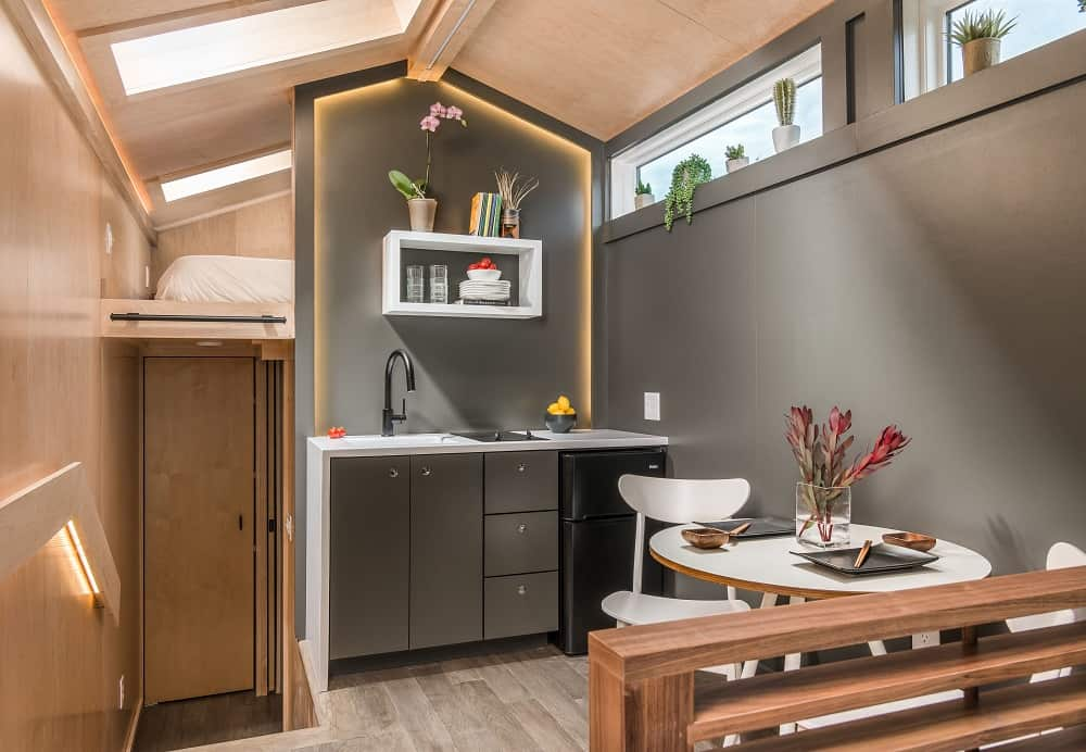 Eat-in kitchen in the Orchid Tiny House designed by New Frontier Tiny Homes.