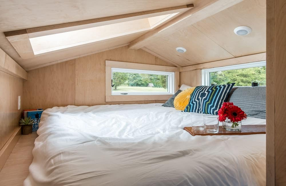 Bedroom in the Orchid Tiny House designed by New Frontier Tiny Homes.