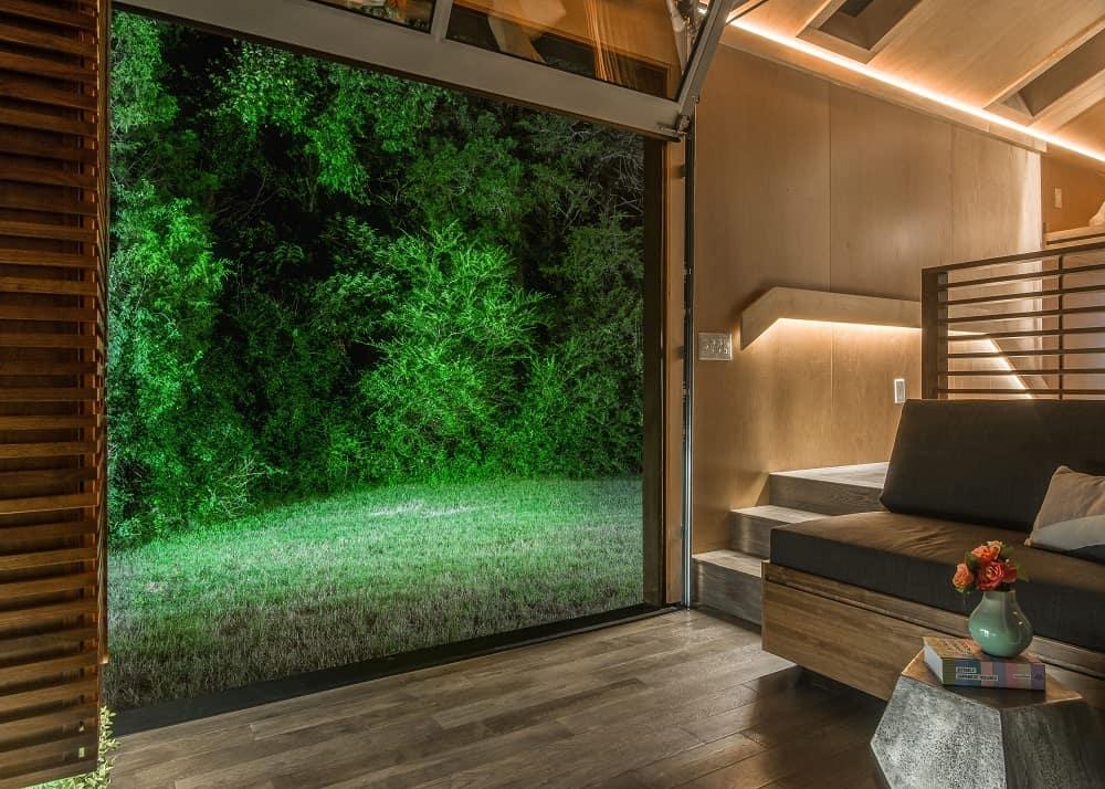 Backyard view from the living room in the Orchid Tiny House designed by New Frontier Tiny Homes.