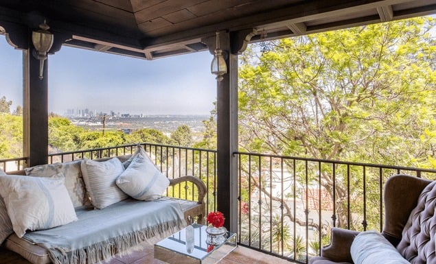 The balcony offers a set of nice seatings. The area overlooks the magnificent view of the city. Images courtesy of Toptenrealestatedeals.com.