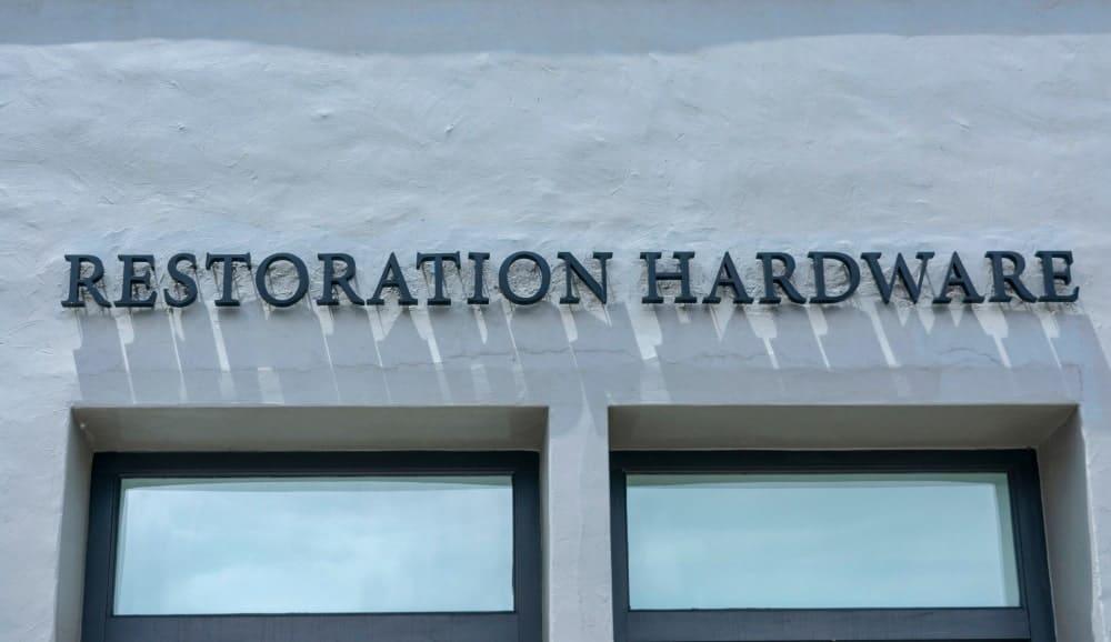 Restoration Hardware trademark logo on retail store.