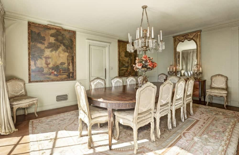 A dining room boasting an elegant set of dining table and chairs, set on top of a massive area rug covering the hardwood flooring. Images courtesy of Toptenrealestatedeals.com.