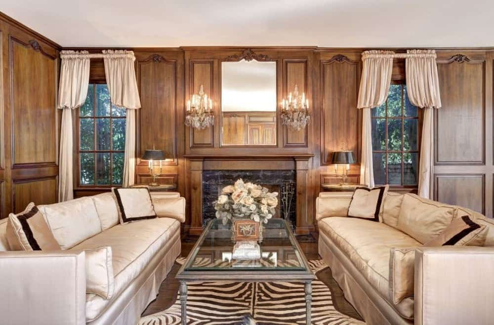 Another formal living room offering two classy couches and a glass top center table on top of a stylish area rug. There's a fireplace as well, lighted by gorgeous wall lights. Images courtesy of Toptenrealestatedeals.com.