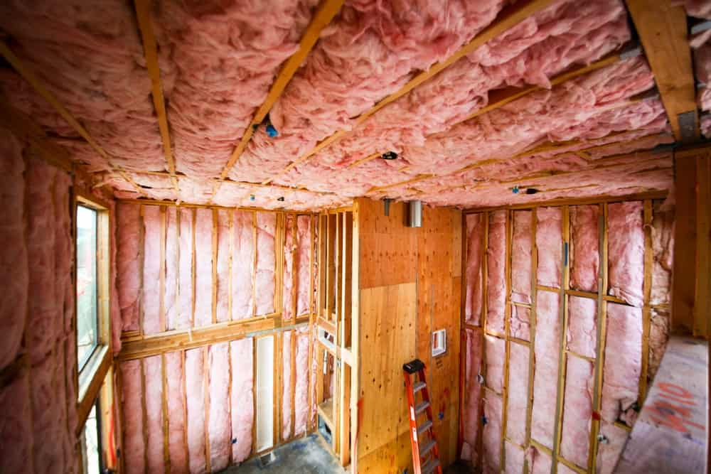 Room with walls covered with pink colored thermal insulation.