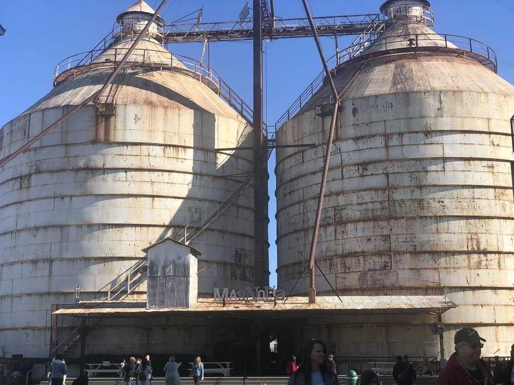 A grand view of the two historical silos that serve as a landmark in town.