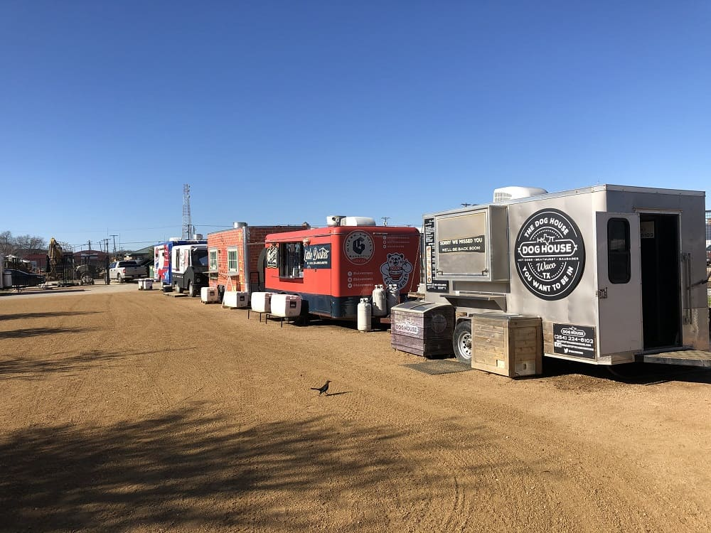 The row of food trucks serving various delicious food from grilled cheese to hotdogs.