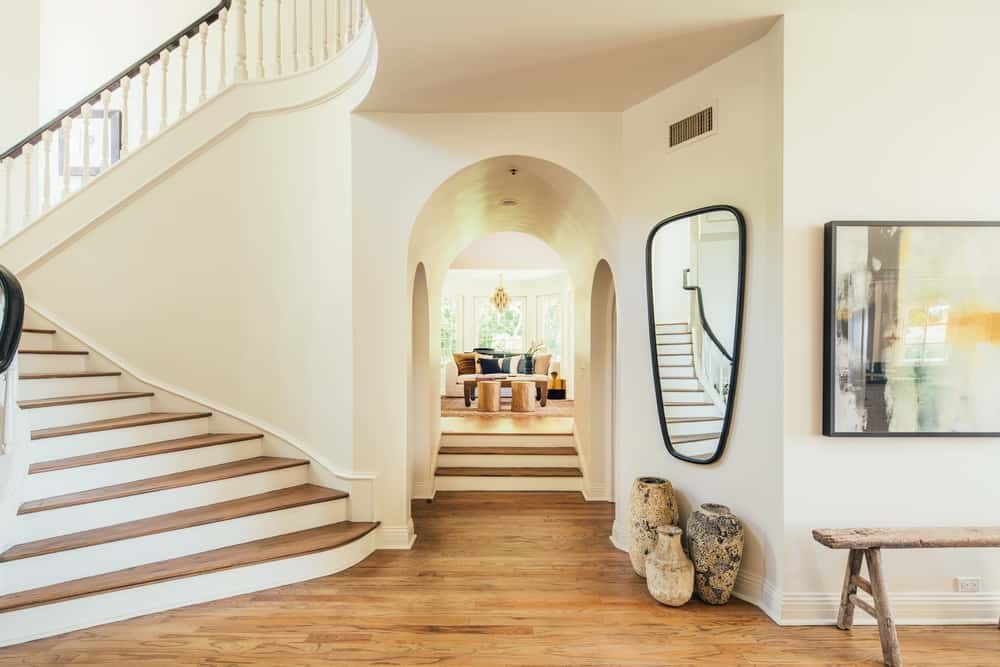 The entry features a staircase on the side leading to the second floor while there's a hallway in front leading to the living space. Images courtesy of Toptenrealestatedeals.com.