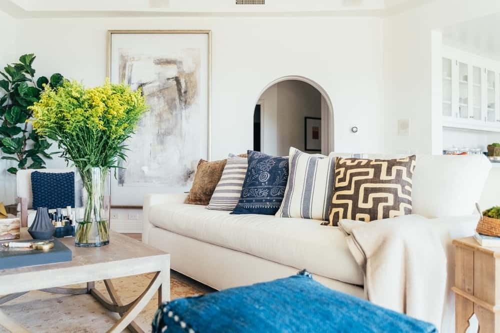 A focused look at the living space's sofa with five stylish throw pillows. Images courtesy of Toptenrealestatedeals.com.