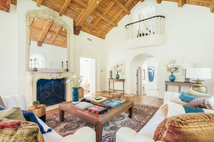 Here's the home's living space offering a comfy set of seats along with a wooden center table on top of a stylish area rug. The room also offers a classy-looking fireplace. Images courtesy of Toptenrealestatedeals.com.