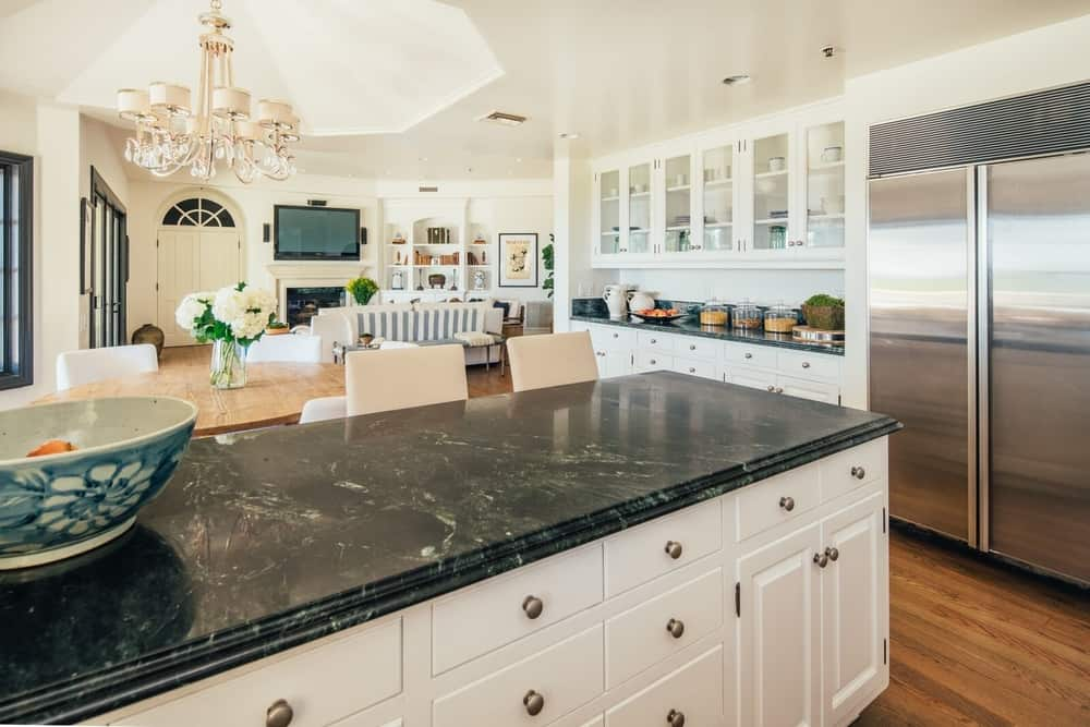 Here's a closer look at the kitchen's breakfast bar island, boasting a black marble countertop. Images courtesy of Toptenrealestatedeals.com.