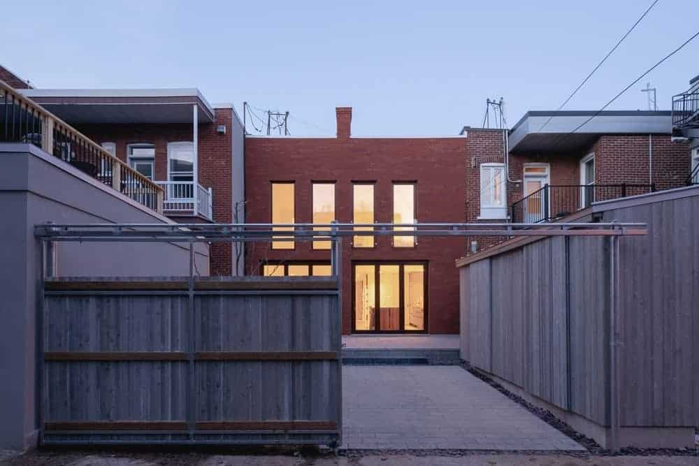 This house boasts a wooden sliding gate entry along with its gorgeous red brick exterior.