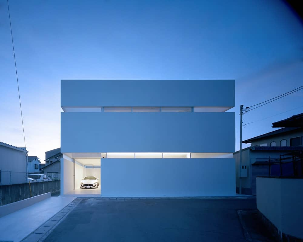 Front exterior at night of the House in Takamatsu designed by Fujiwaramuro Architects.