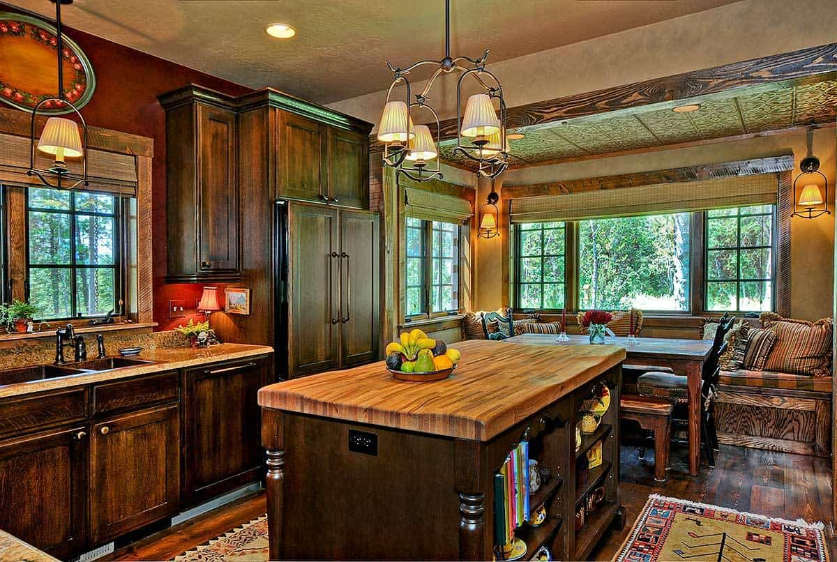The kitchen has rustic cabinetry and a wooden island illuminated by a vintage chandelier. An open dining area sits on the side.