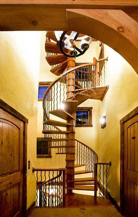 Antique oak spiral staircase leading to the lower level of the house.